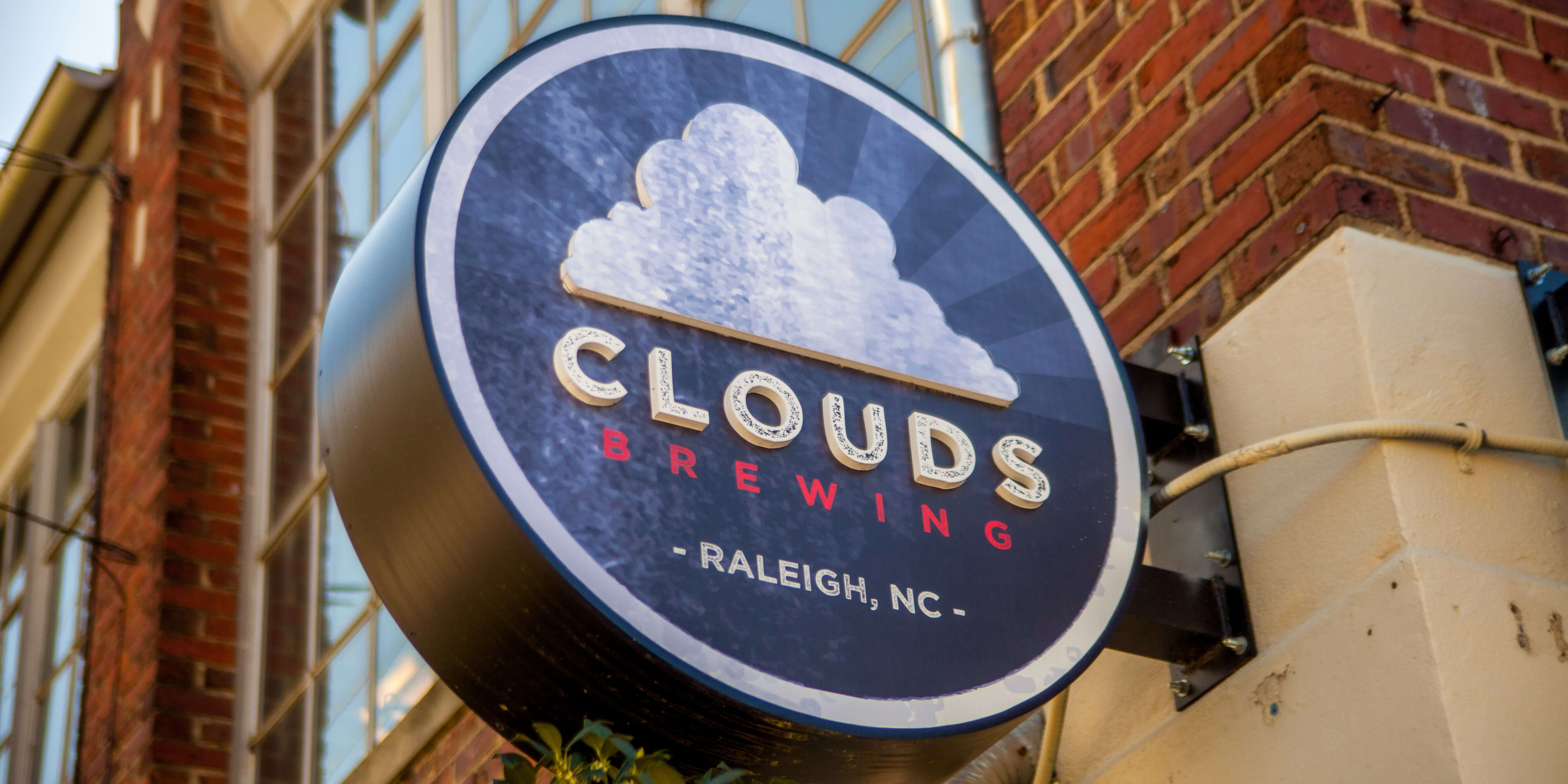 Sign at the front entrance of Clouds Brewing in downtown Raleigh, North Carolina
