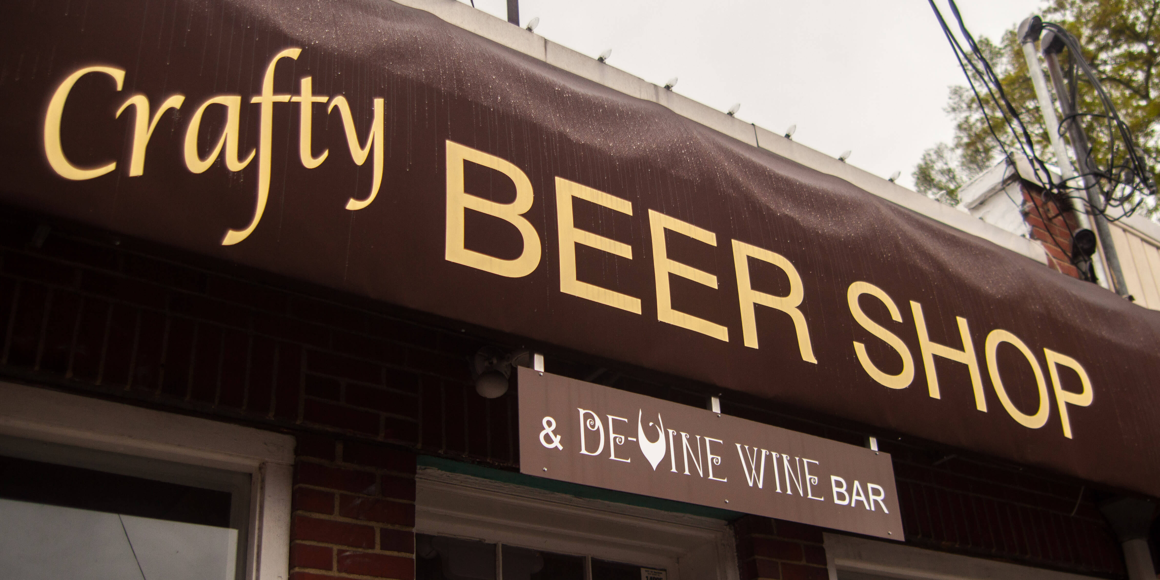 Sign at the front entrance of Crafty Beer Shop in Raleigh, North Carolina